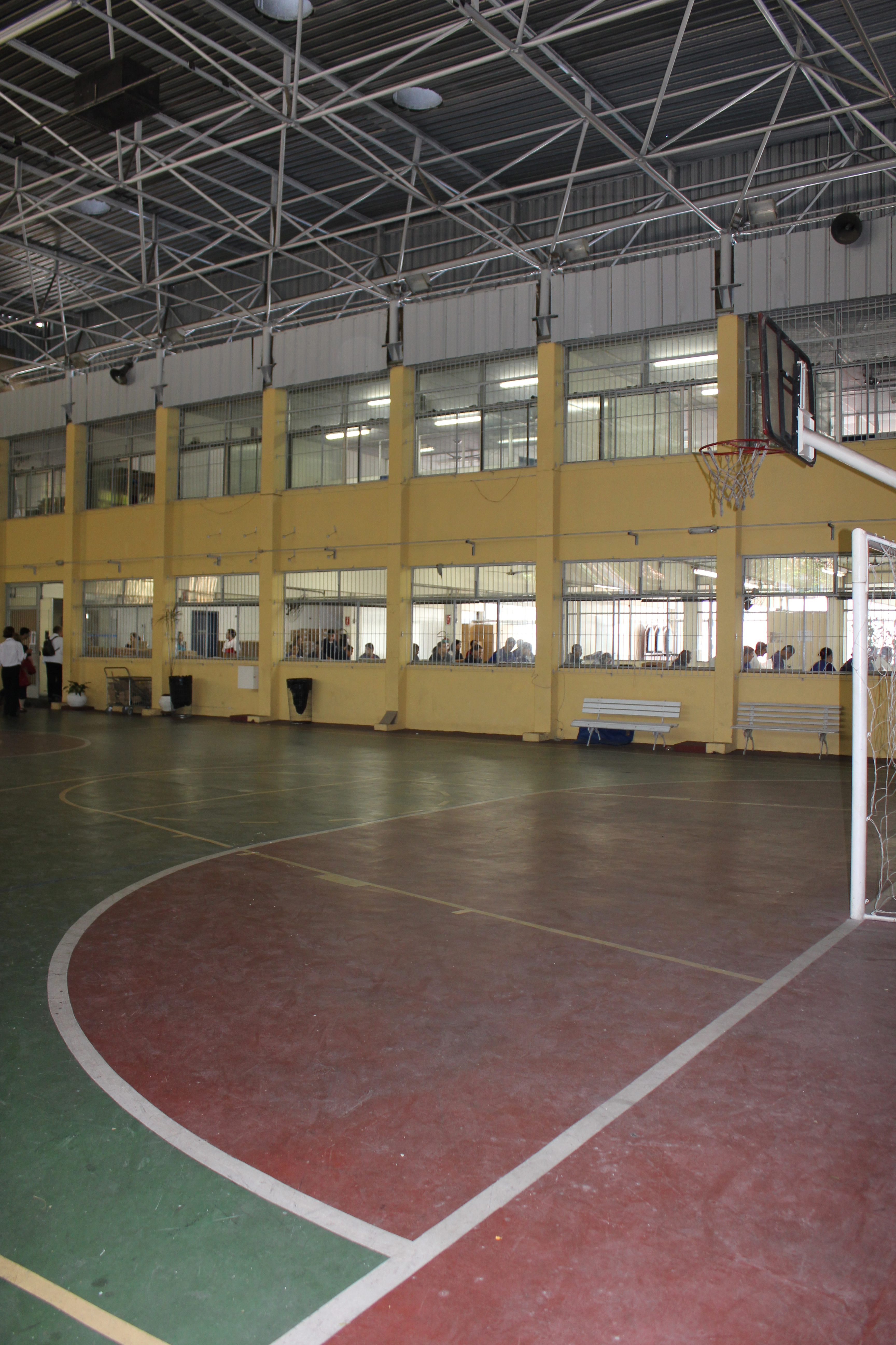 Indoor basketball court looking into windows of vocational training area